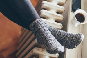 warming-feet-at-radiator